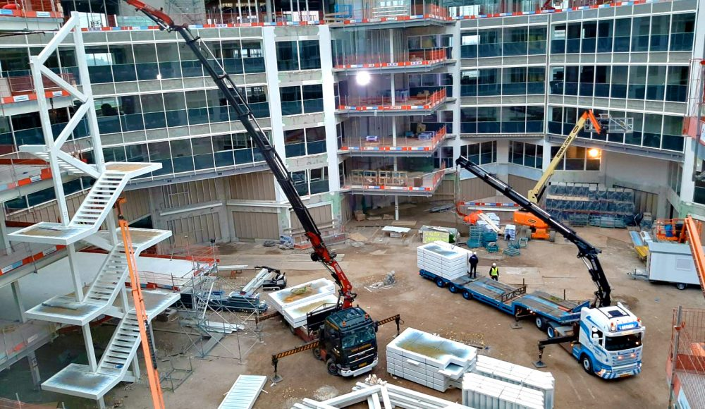 A-Fassi-F660RA-he-dynamic-and-a-F710RA-xhe-dynamic-crane-in-action-into-a-construction-site-at-Amsterdam-3